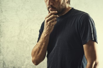Forgetful Man Having Problems Remembering Something Important Hand on Chin.