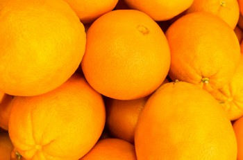 orange fruits - pile of oranges / stack of oranges