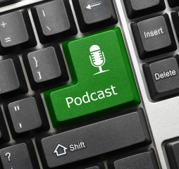 Close up view on conceptual keyboard - Podcast (green key)