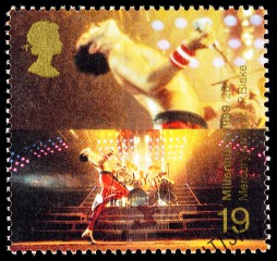 UNITED KINGDOM - CIRCA 1999: A used postage stamp printed in Britain celebrating Entertainers showing Freddie Mercury the Lead Singer of the Pop Music Band Queen