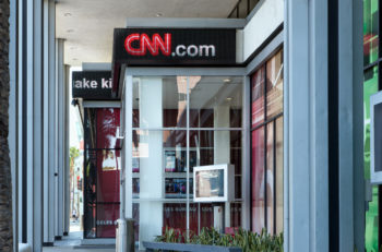 HOLLYWOOD CA/USA - MAY 2 2015: CNN building exterior and logo. Cable News Network (CNN) is an American basic cable and satellite television channel that is owned by Time Warner.