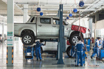 PHUKET THAILAND - MARCH 10 : Car technician repairing car in workshop service station in Phuket on March 10 2015. The official dealer of Toyota who is the top market share for commercial car.