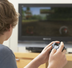 Teenage Boy Playing With Game Console