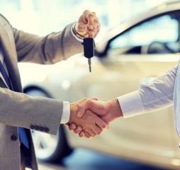 auto business, car sale, deal, gesture and people concept - clos