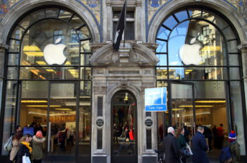 London, England - January 24, 2015: People in front of and inside the main entrance of the Apple store in Regent Street, London. In January 2015 Apple  posted record quarterly revenue of $74.6 billion