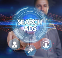 Business Technology Internet and network concept. Young businessman select on the virtual display: search ads