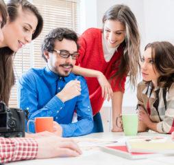 Team in creative agency discussing in meeting having idea brains