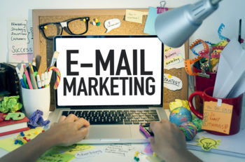E-mail marketing business concept with laptop in office