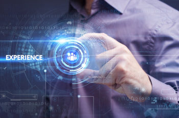 Business Technology Internet and network concept. Young businessman working on a virtual screen of the future and sees the inscription: experience
