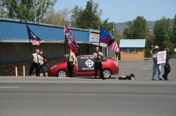 Neo Nazi/White Supremacy Socialist Party demonstrators waving flags in Phoenix, Or usa Sunday April 26 2009