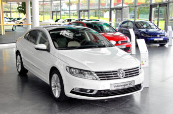 WOLFSBURG GERMANY - AUGUST 14 2014: Brand new saloon car Volkswagen Passat CC in the trade center of the Volkswagen Autostadt.