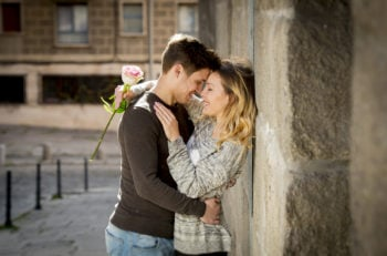 Candid Portrait Of Beautiful European Couple With Rose In Love K