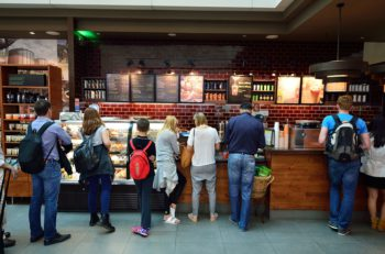 DUBAI, UAE - JUNE 23, 2015: Starbucks cafe interior. Starbucks Corporation, doing business as Starbucks Coffee, is an American global coffee company and coffeehouse chain based in Seattle, Washington