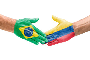 Handshake Brazil and Colombia on a white background