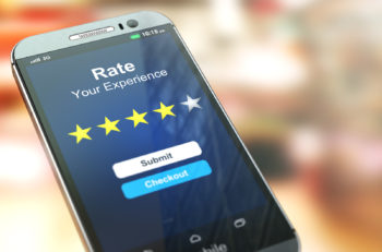 Smartphone or mobile phone with text rate your experience on the screen.  Online feedback rating and review concept. 3d illustration