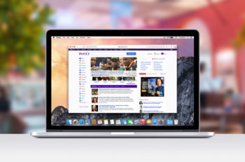 Varna Bulgaria - November 03 2013: Directly front view of Apple 15 inch MacBook Pro Retina with an open tab in Safari which shows Yahoo web page. Blurred ice cream cafe on the background.