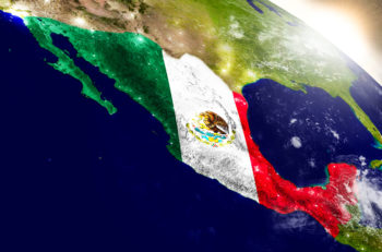 Mexico with embedded flag on planet surface during sunrise. 3D illustration with highly detailed realistic planet surface and visible city lights. Elements of this image furnished by NASA.