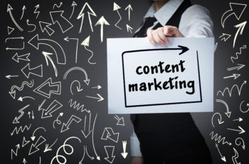 Technology internet business and marketing. Young business woman writing word: Content marketing