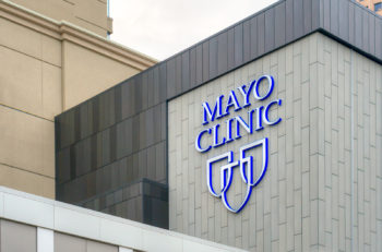 MINNEAPOLIS MN/USA - MAY 23 2016: Mayo Clinic entrance and sign. The Mayo Clinic is a nonprofit medical practice and medical research group based in Rochester Minnesota.