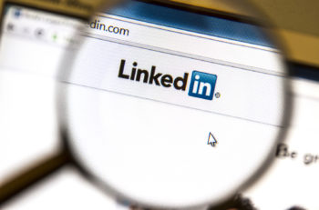 Ostersund, Sweden -August 3, 2014:  Linkedin website under a magnifying glass.  Linkedin is a business oriented social networking website.
