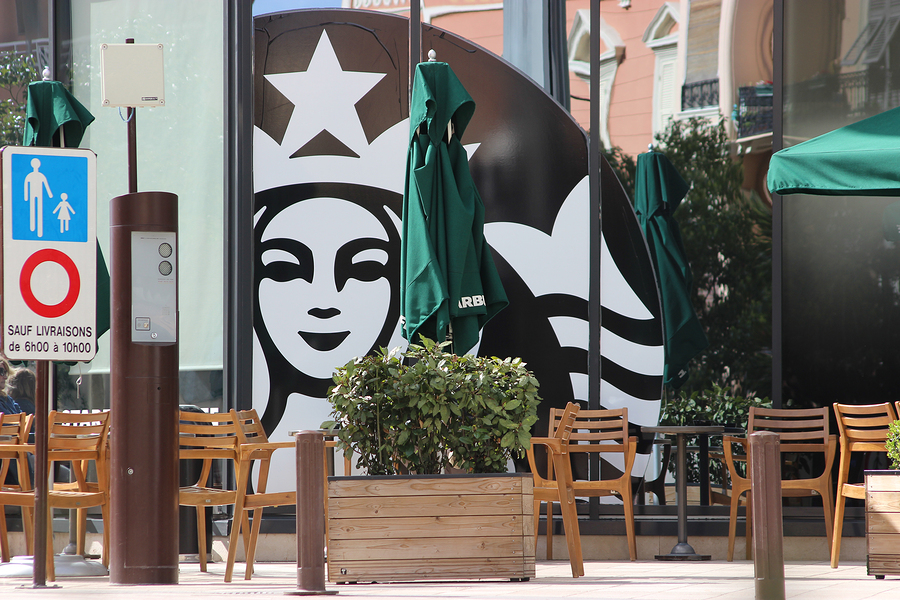 Monte-Carlo Monaco - March 9 2016: Starbucks Sign is Displayed at the Facade of a Starbucks Store. Starbucks Corporation is an American Coffee Company and the Largest Coffeehouse Company in the world with 23450 Stores in 67 Countries