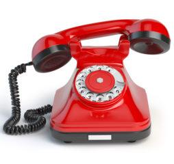 Vintage red telephone isolated on white background. 3d illustration. Retro styled telephone