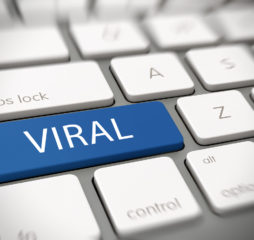 Viral online marketing, brand awareness or meme concept with the word - Viral - on a blue enter button on a computer keyboard with blur vignette. 3d Rendering.