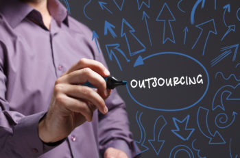 Technology internet business and marketing. Young business man writing word: outsourcing