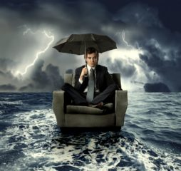 businessman on an armchair lost in the sea