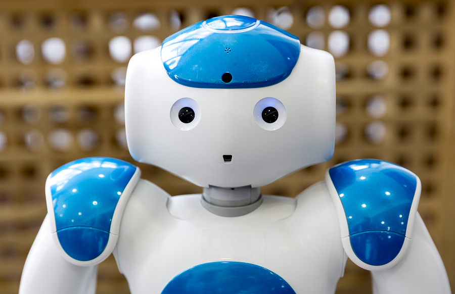 A small robot with human face and body - humanoid. Artificial Intelligence - AI. Blue robot. Blue robots isolated on white background.