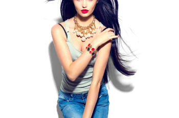 Beauty fashion model girl with long straight flying hair, beautiful make up, Beautiful brunette young woman full length portrait. Stylish woman dressed in jeans, fashionable clothes and accessories.