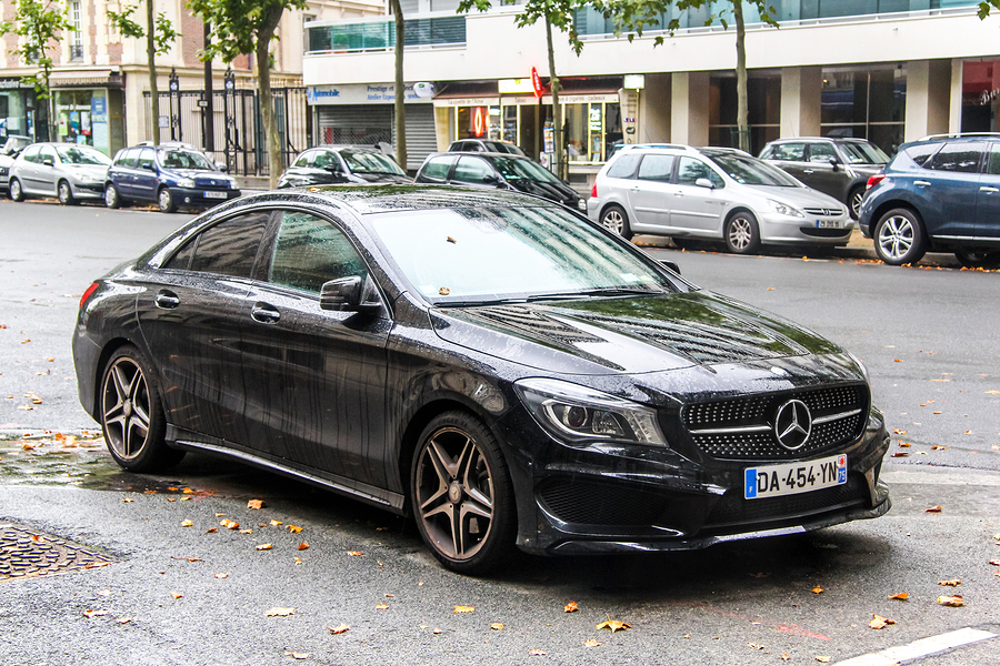 PARIS FRANCE - AUGUST 8 2014: Motor car Mercedes-Benz C117 CLA-class in the city street.