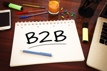 B2B - Business to Business - handwritten text in a notebook on a desk - 3d render illustration.