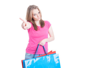 No more spending money concept with young shopaholic after a day of shopping isolated on white with copyspace
