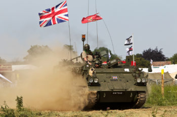 WESTERNHANGER, UK - JULY 17: An ex British army FV432 armoured vehicle gives a display for the public at the War & Peace show on July 17, 2013 in Westernhanger