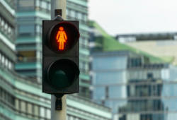 Red Woman Pedestrian Signal. Many Traffic Lights With Female Fig